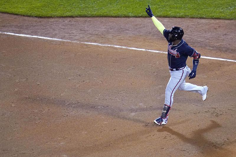 Marcell Ozuna of the Atlanta Braves reacts after hitting. home run