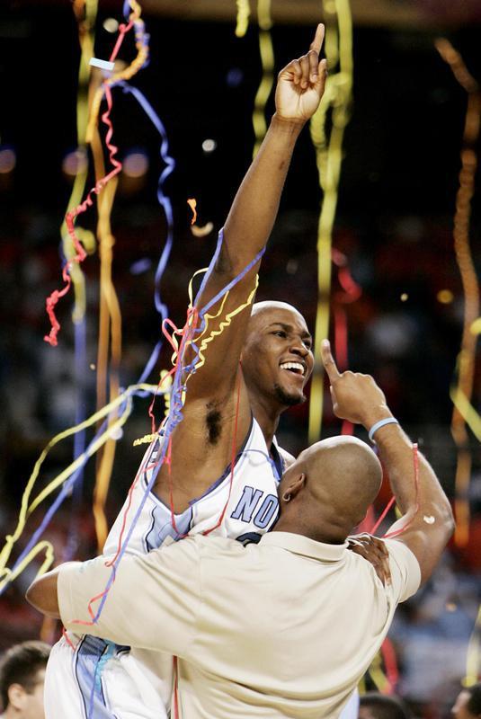 Jawad Williams celebrates after Tar Heels beat Illinois