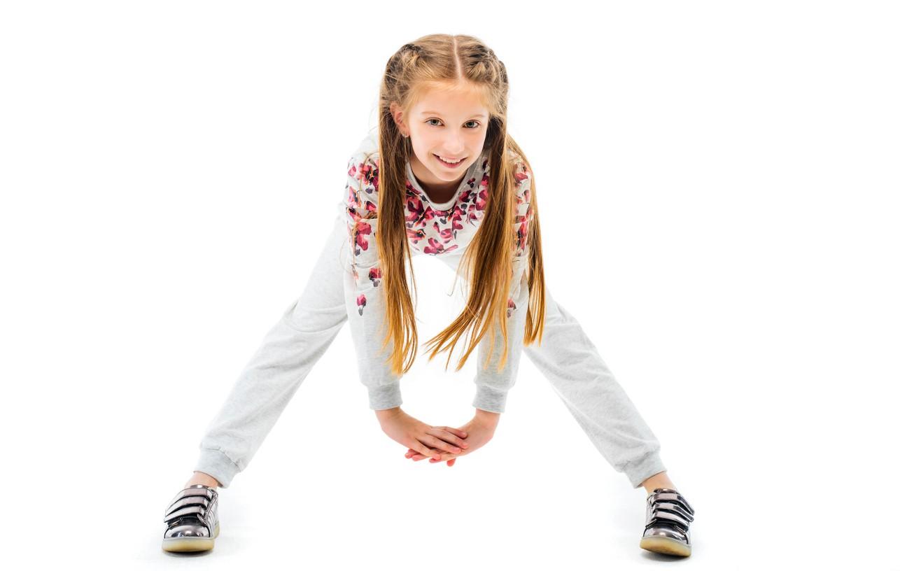 Girl doing yoga for kids