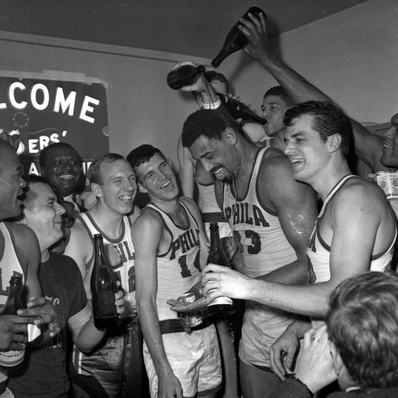Philadelphia 76ers Wilt Chamberlain gets champagne poured on him