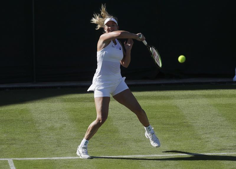 Coco Vandeweghe returns ball during Wimbledon Tennis Championships