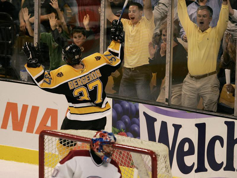 Patrice Bergeron scores and celebrates with fans