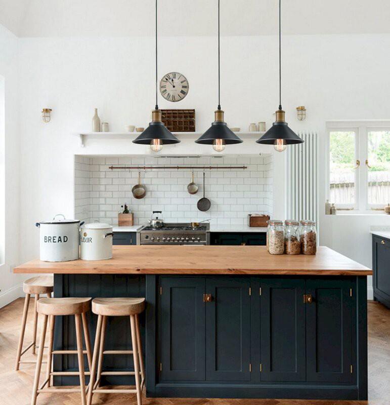 Dark blue kitchen with butcher block countertop