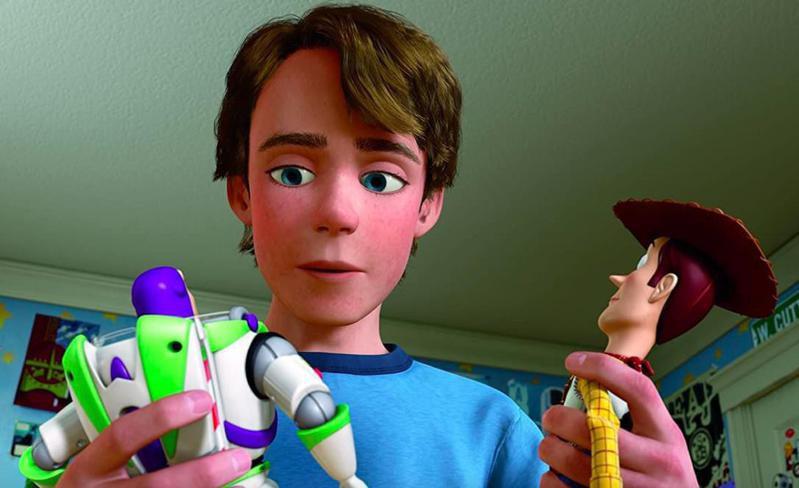 Tom Hanks, Tim Allen, and John Morris in Toy Story 3