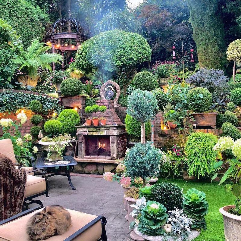 Amazing home garden with outdoor fireplace