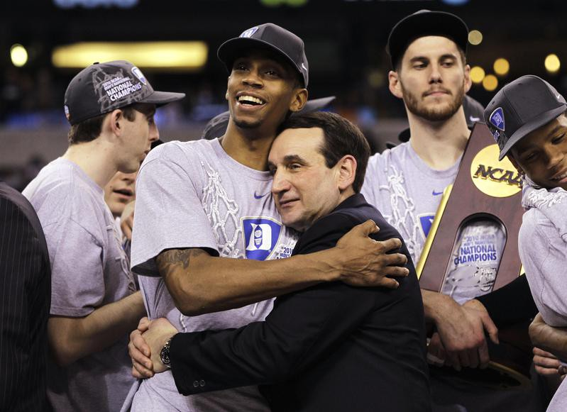 Duke coach Mike Krzyzewski and guard Lance Thomas embrace after win over Butler