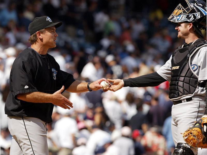 Gregg Zuan hands game ball to John Gibbons
