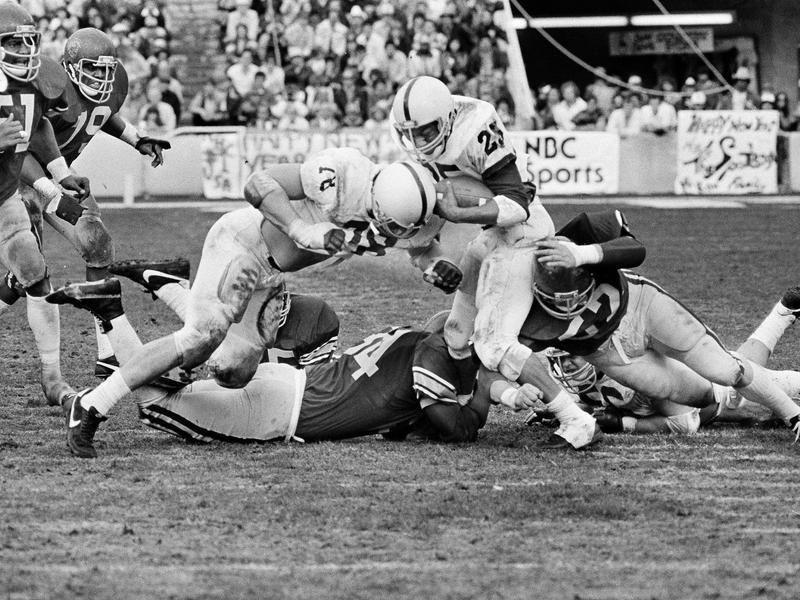 Penn State's Curt Warner gets a few yards