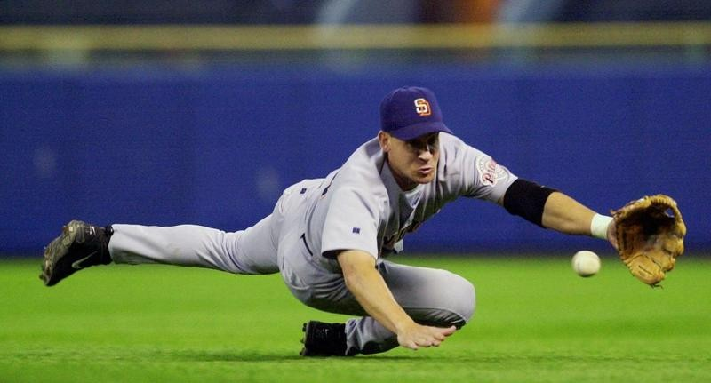Bret Boone dives to field a ball hit by Milwaukee Brewers