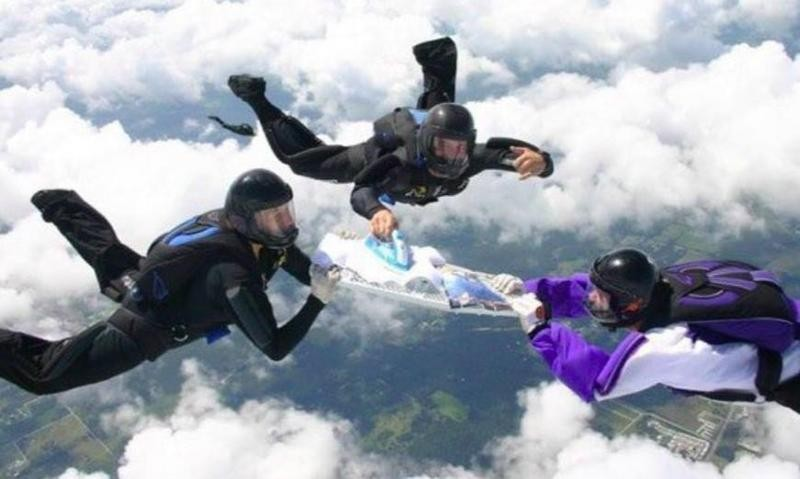 People sky diving while ironing