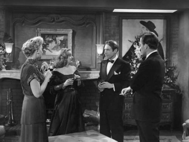 Celeste Holm, Bette Davis, Gary Merrill, Hugh Marlowe speaking to one another