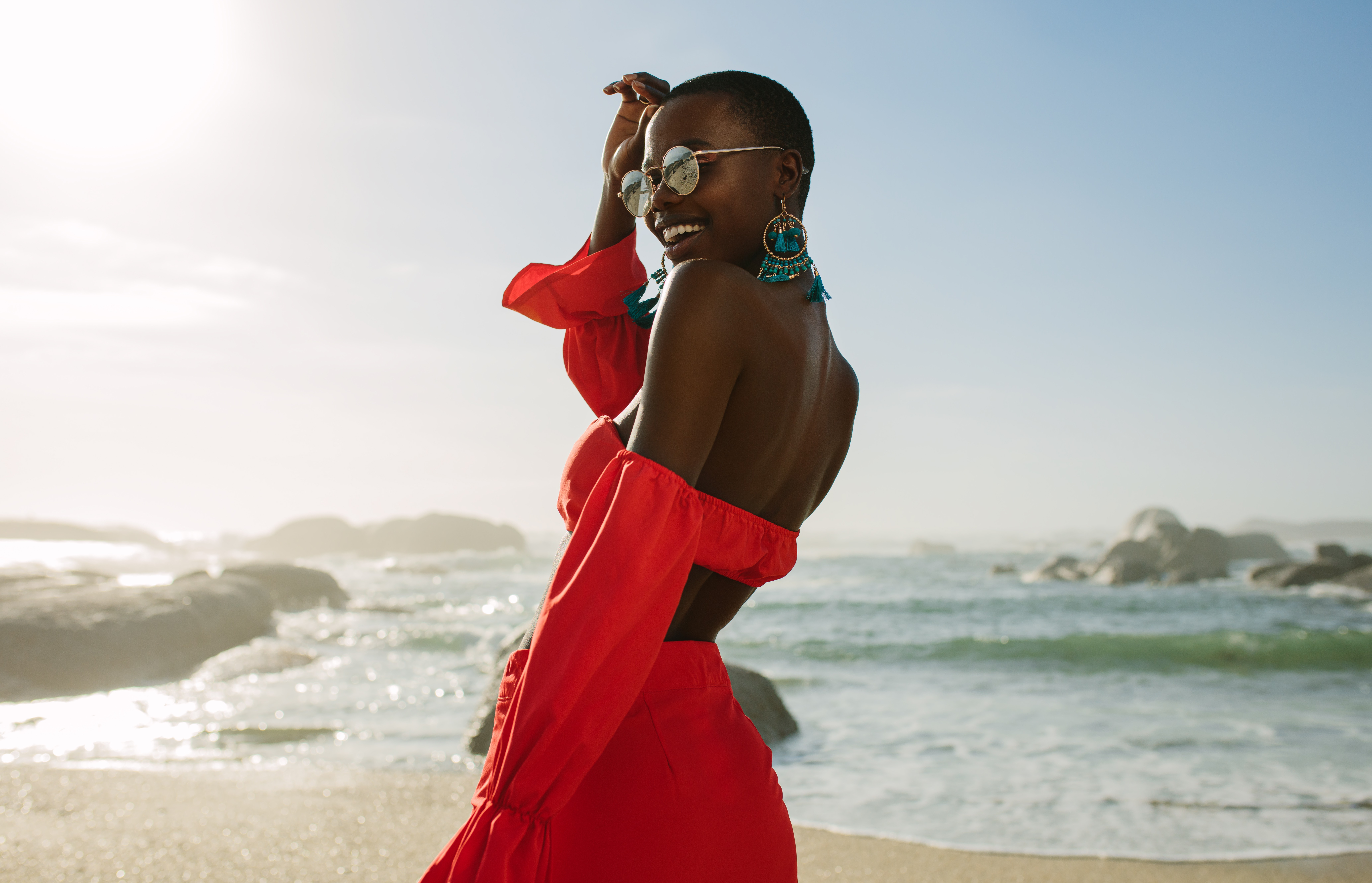 Beautiful woman in red dress on the beach