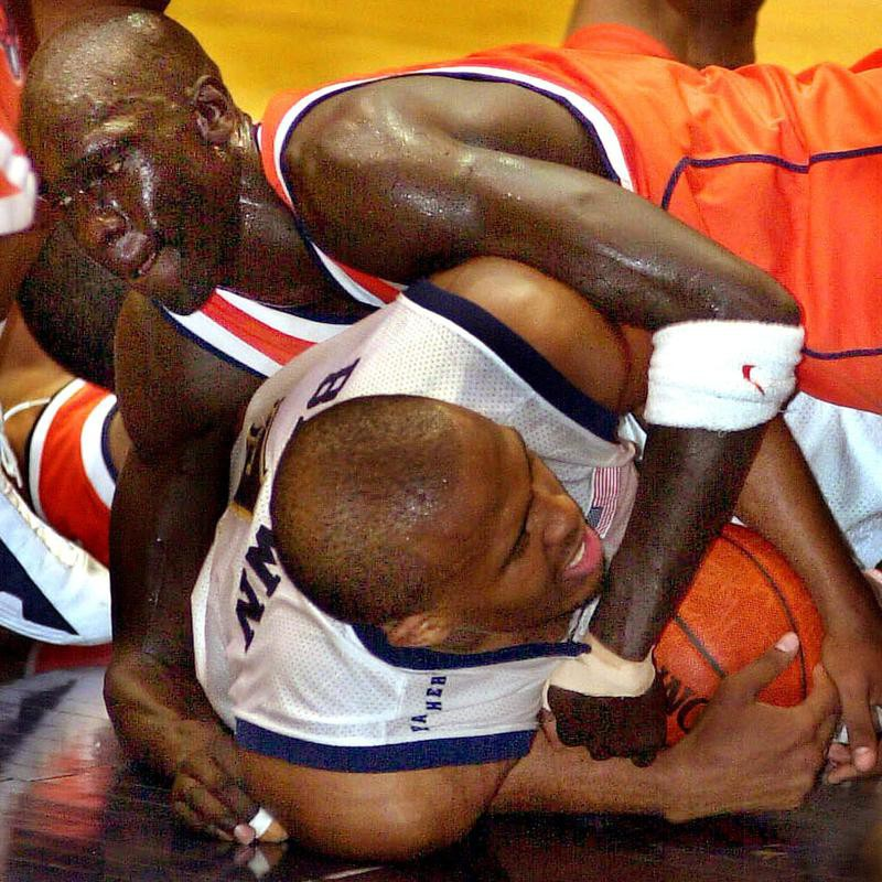 Syracuse's Kueth Duany battles with Pittsburgh guard Jaron Brown