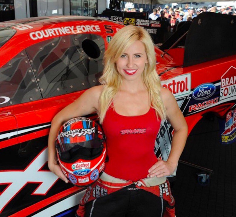 Courtney Force poses with helmet