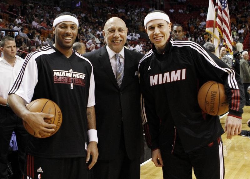 Henry Bibby poses with his son Mike Bibby at Miami Heat game