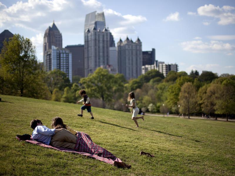 Couple and kids enjoy Piedmont Park