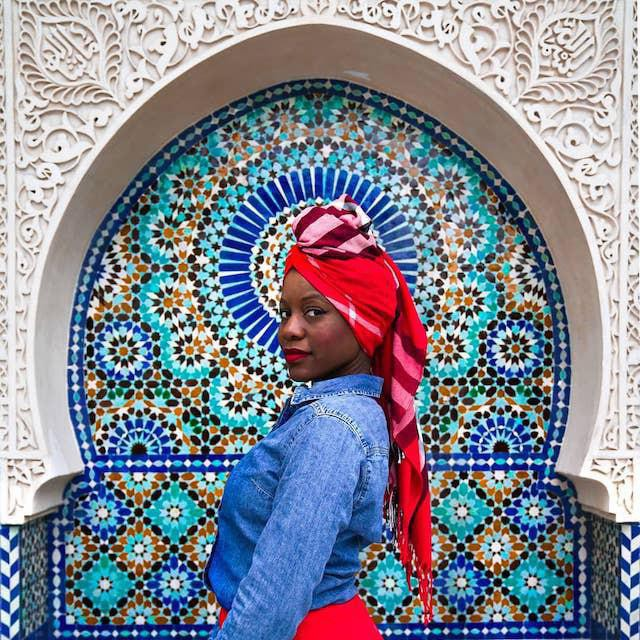 Traveler in front of mosque