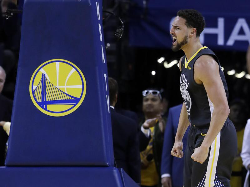 Golden State Warriors' Klay Thompson reacts