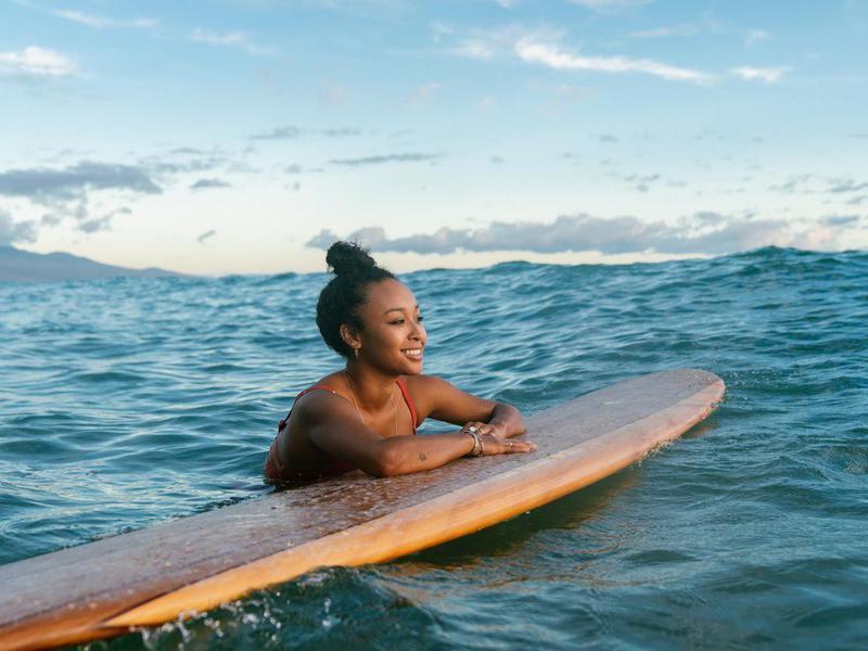 Woman surfing in Hawaii