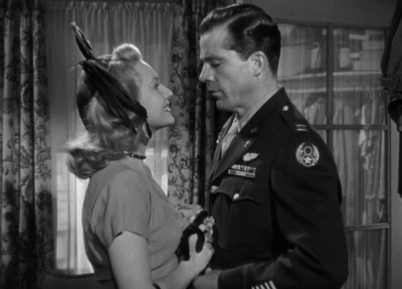 Virginia Mayo smiling at Dana Andrews in The Best Years of Our Lives