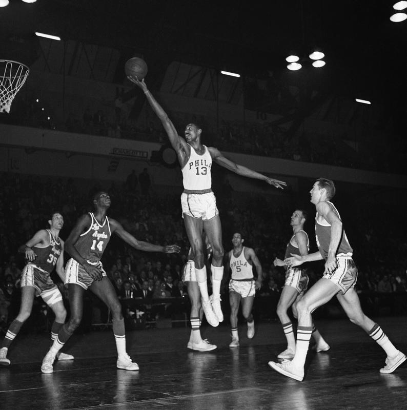 Wilt Chamberlain goes up for basket