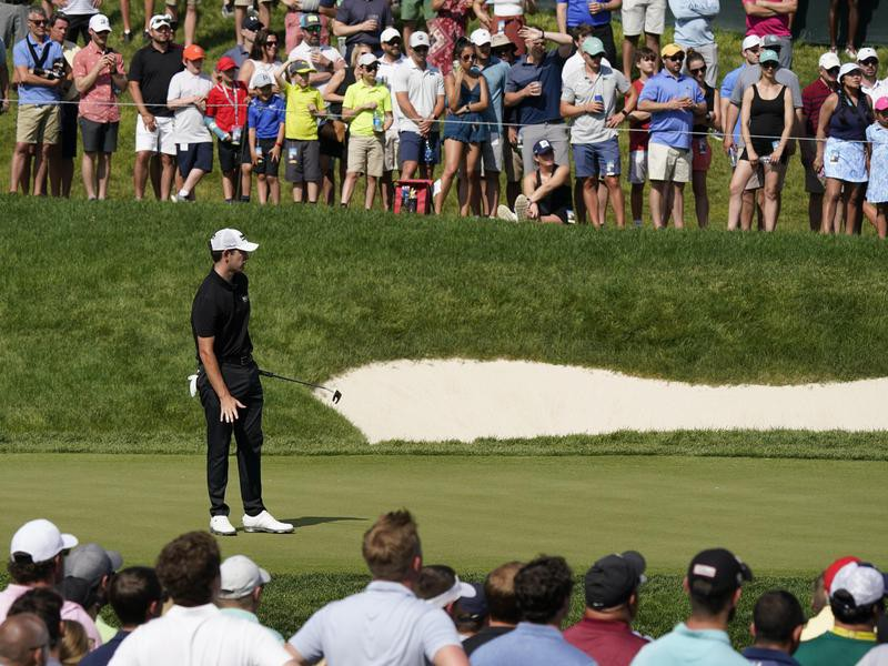 Patrick Cantlay watches hits putt at 2021 Memorial Tournament