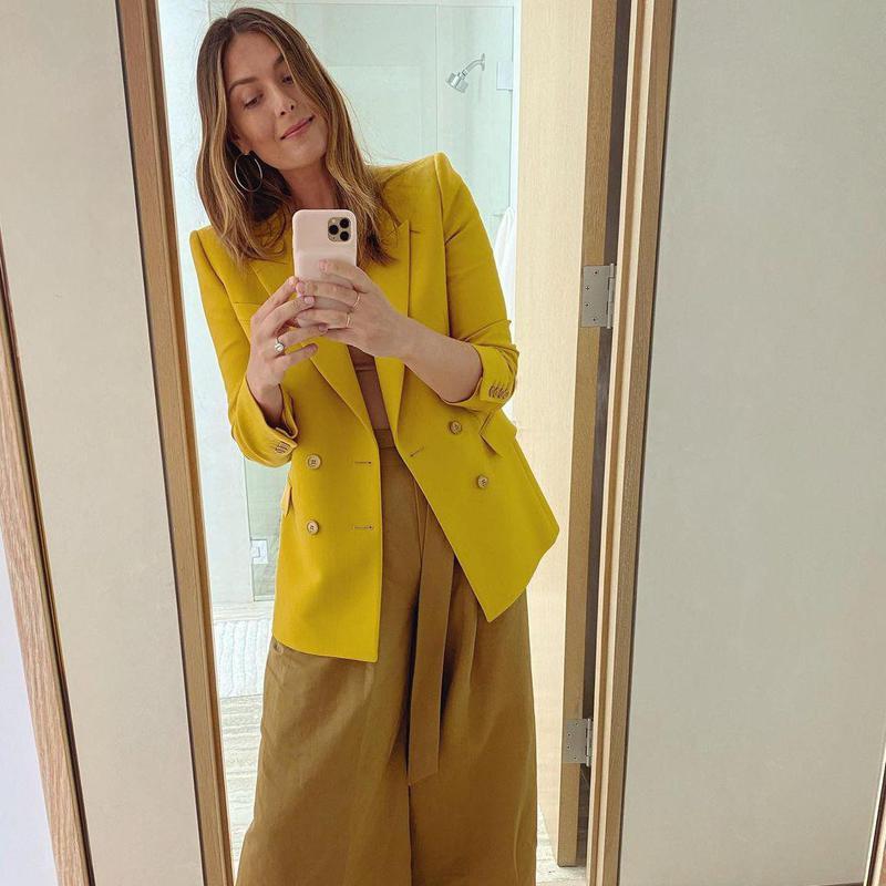 Maria Sharapova posing in stylish outfit