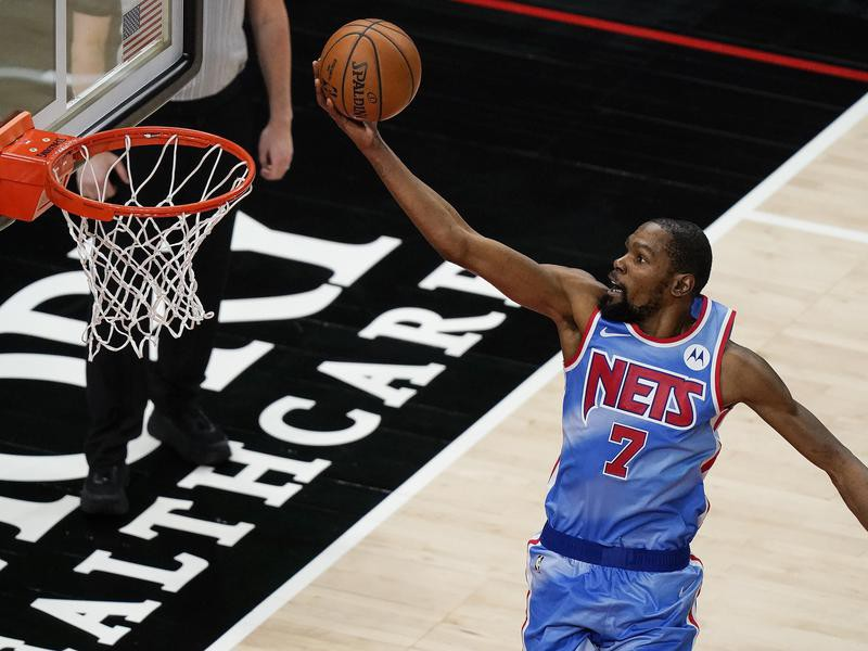 Brooklyn Nets forward Kevin Durant scores against Atlanta Hawks