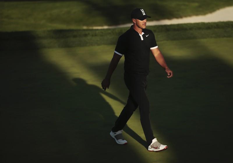 Brooks Koepka walks on 17th green