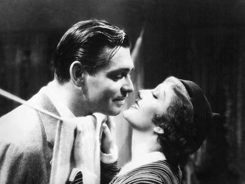 Claudette Colbert smiling at Clark Gable in It Happened One Night