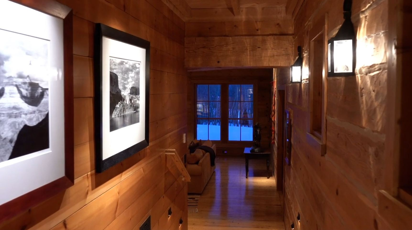 Wood hallway with white pictures