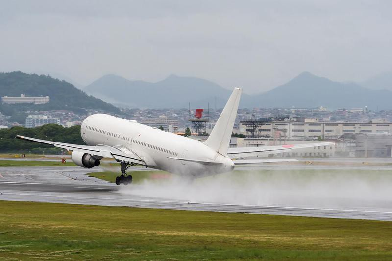 Plane on wet runway