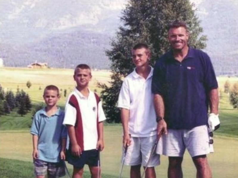 Howie poses with sons Chris, Kyle, and Howie Jr. while playing golf
