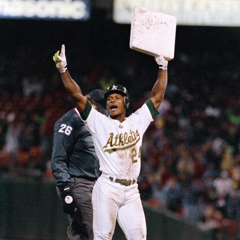 Rickey Henderson reacts with a base