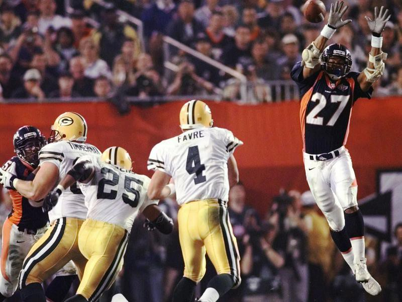 Steve Atwater jumps into air in attempt to block Green Bay Packers quarterback Brett Favre's pass