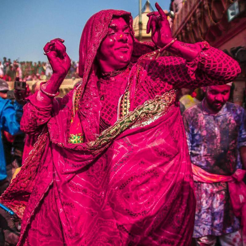 Woman dancing during Holi