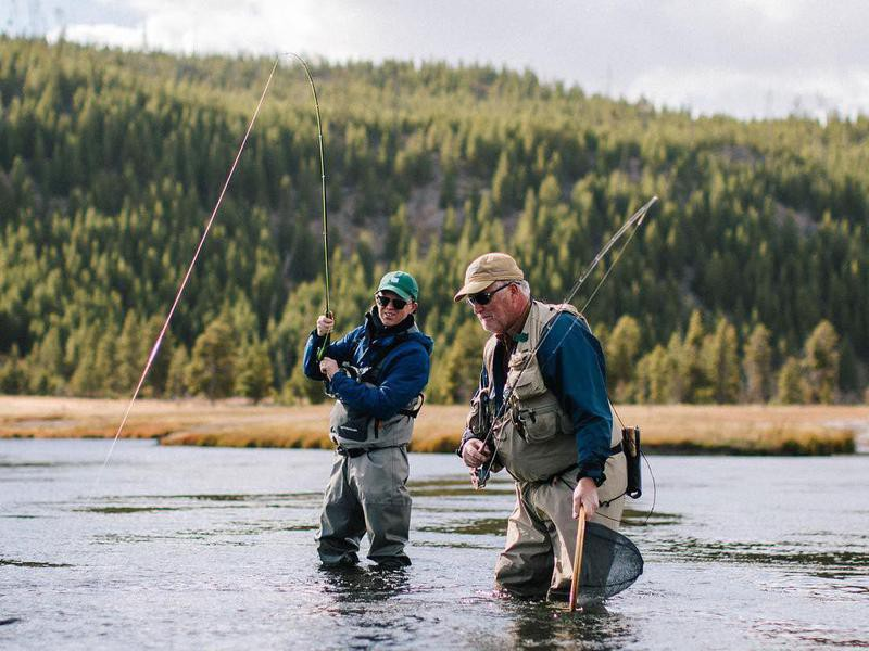 Fishing in Firehole River, Yellowstone National Park