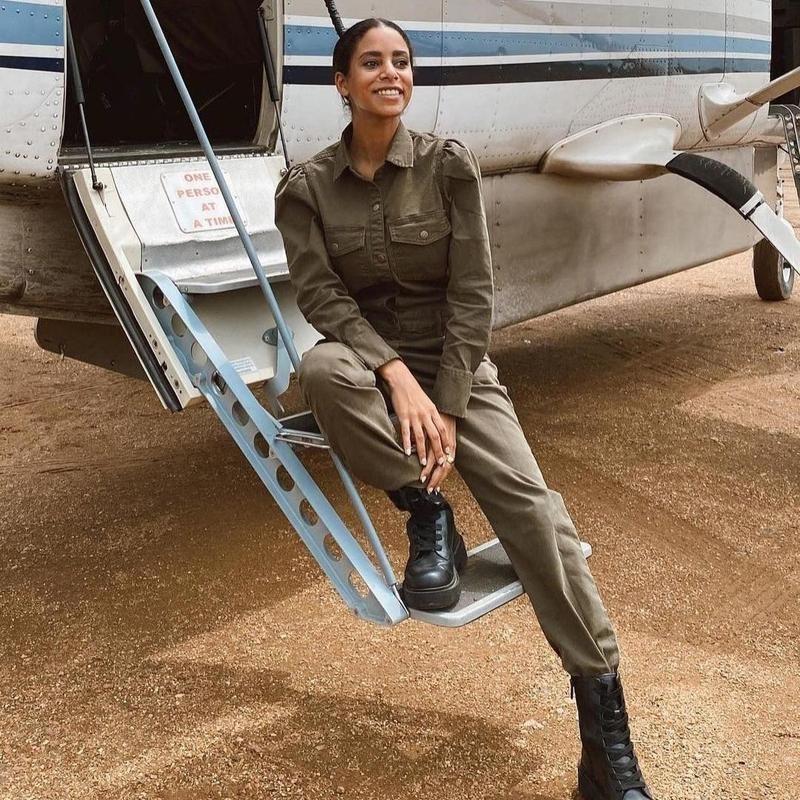 Woman in flightsuit