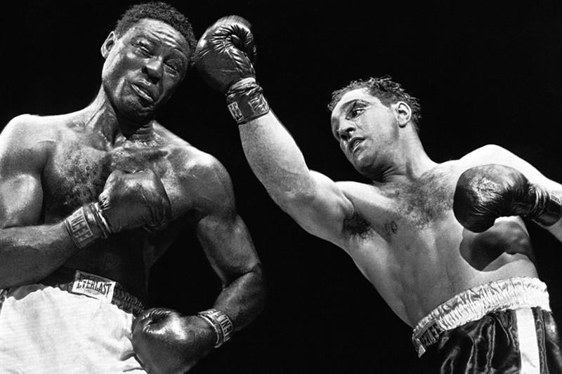 Rocky Marciano beats Ezzard Charles in 1954