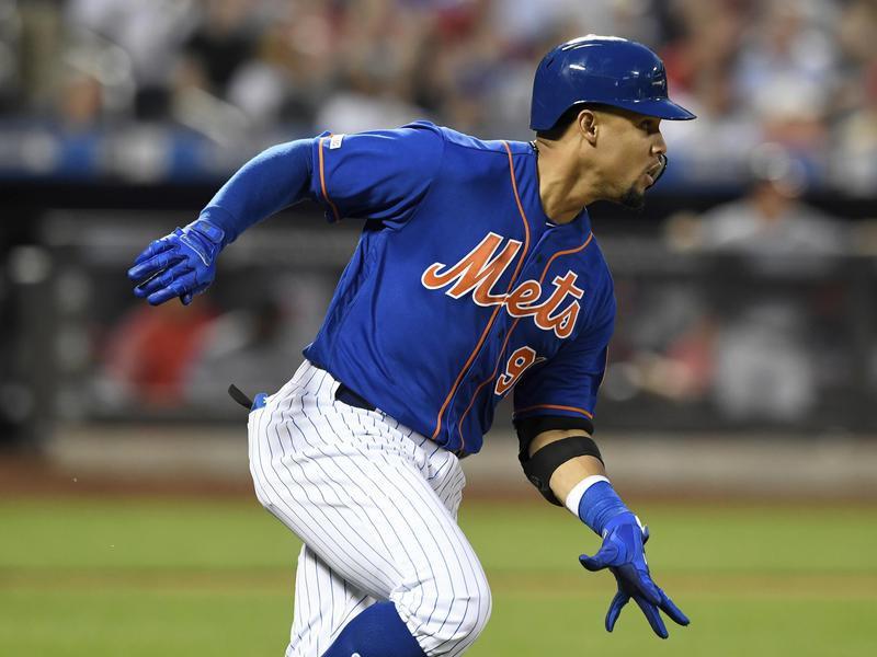 Carlos Gomez runs to first base