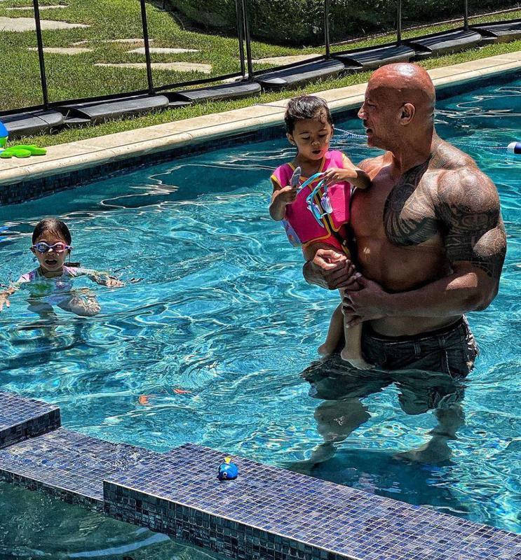 Dwayne Johnson in a pool