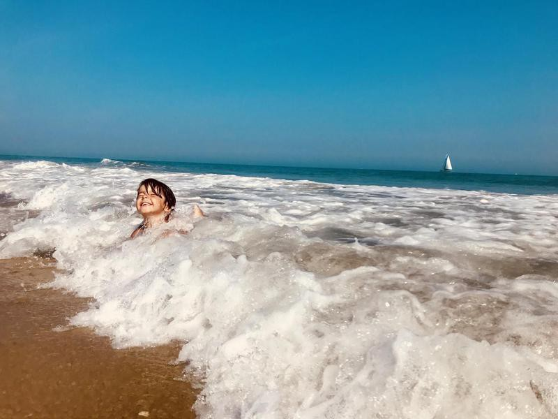 Boy playing in the ocean in Jersey Shore, New Jersey