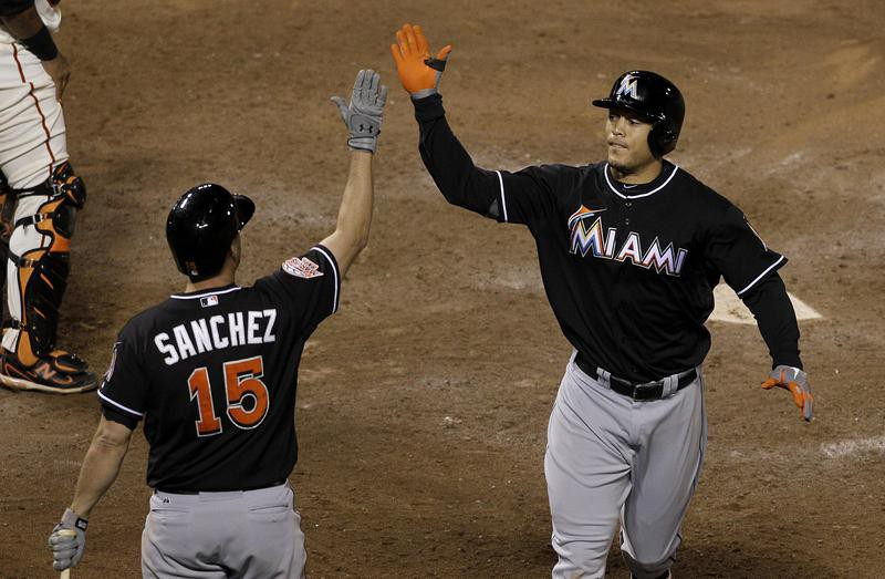 Giancarlo Stanton celebrates with Gaby Sanchez