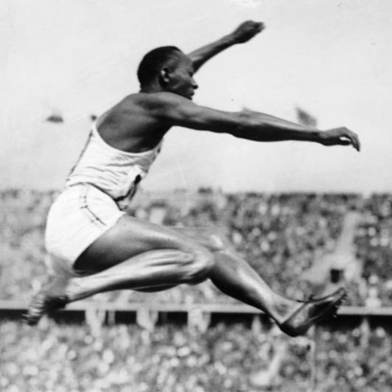 Jesse Owens jumping