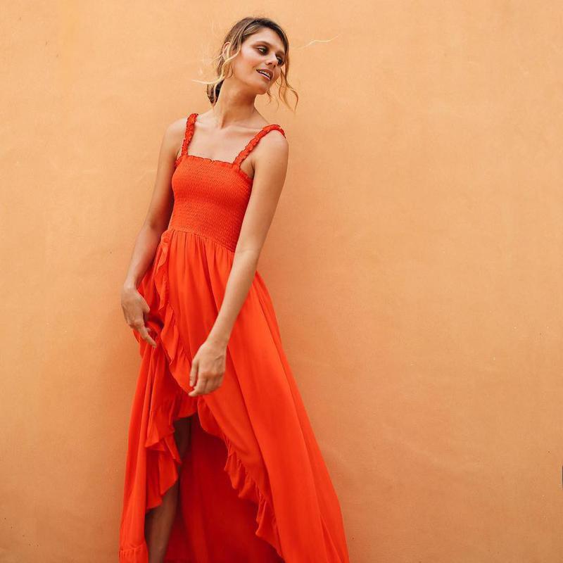 Woman wearing tangerine dress