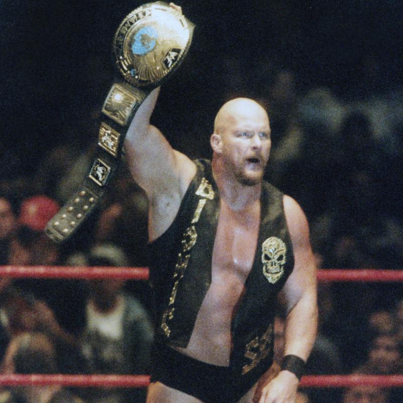 Steve Austin holding belt