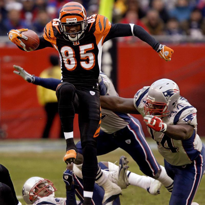 Chad Johnson of the Cincinnati Bengals leaps over New York Patriots defenders