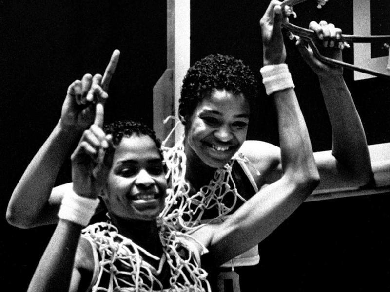 Pam McGee and her twin Paula of University of Southern Carolina pose after winning the NCAA women's basketball championship
