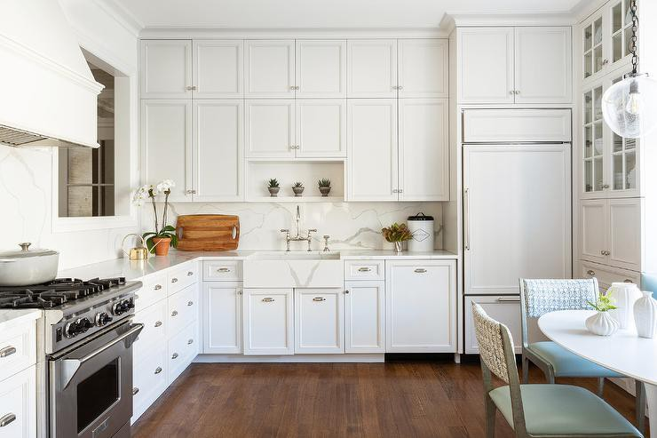 Kitchen with white cabinets and quartz farmhouse sink