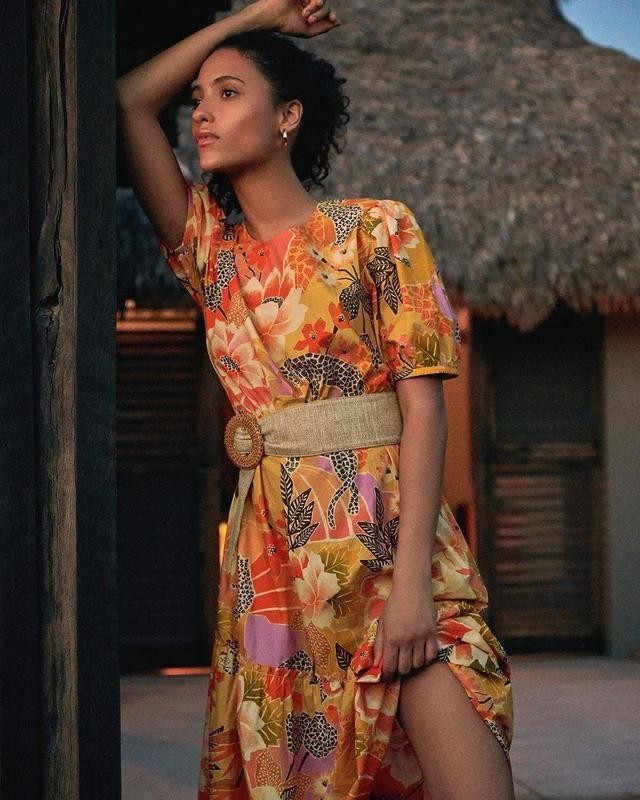 Woman leaning in floral dress